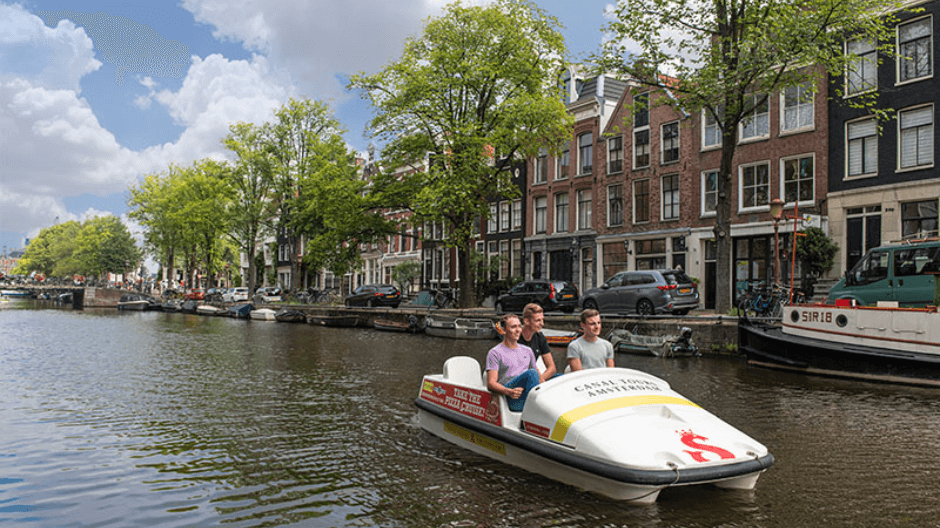 Staycation in Amsterdam - pedal boating.png
