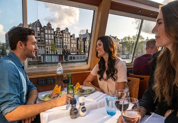 Couple enjoys a dinner cruise with a beautiful sunset