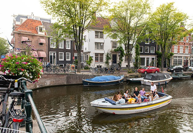 A small open boat tour through the Amsterdam canals