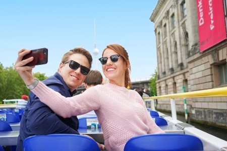 Couple on sightseeing in Berlin taking photo
