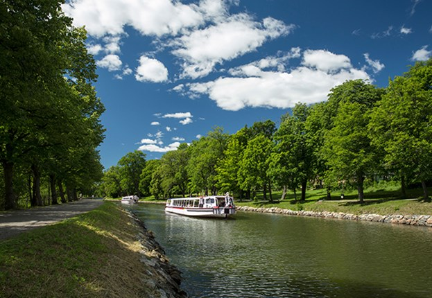 Sightseeing boat in the canal of Royal Djurgården in Stockholm